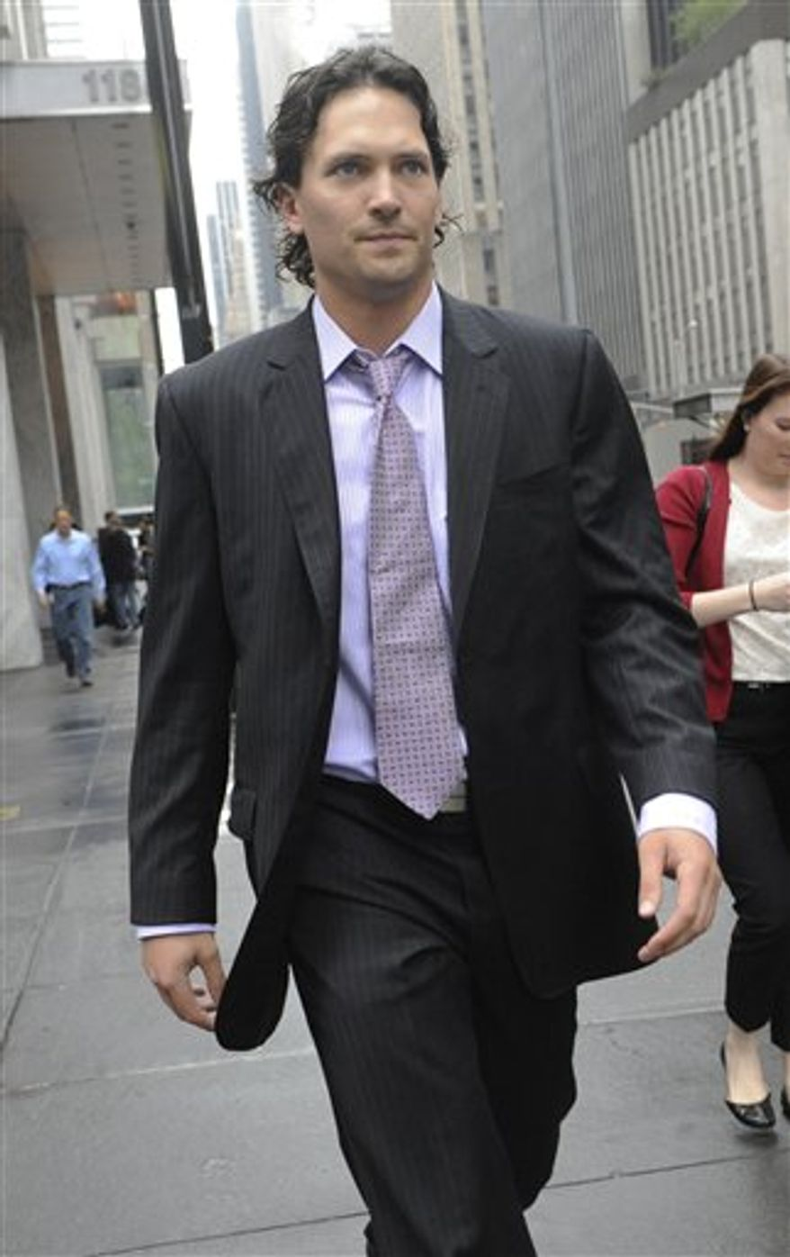 Winnipeg Jets' Ron Hainsey takes a break from a bargaining session at NHL headquarters in New York, Friday, Sept. 28, 2012. (AP Photo/Louis Lanzano)