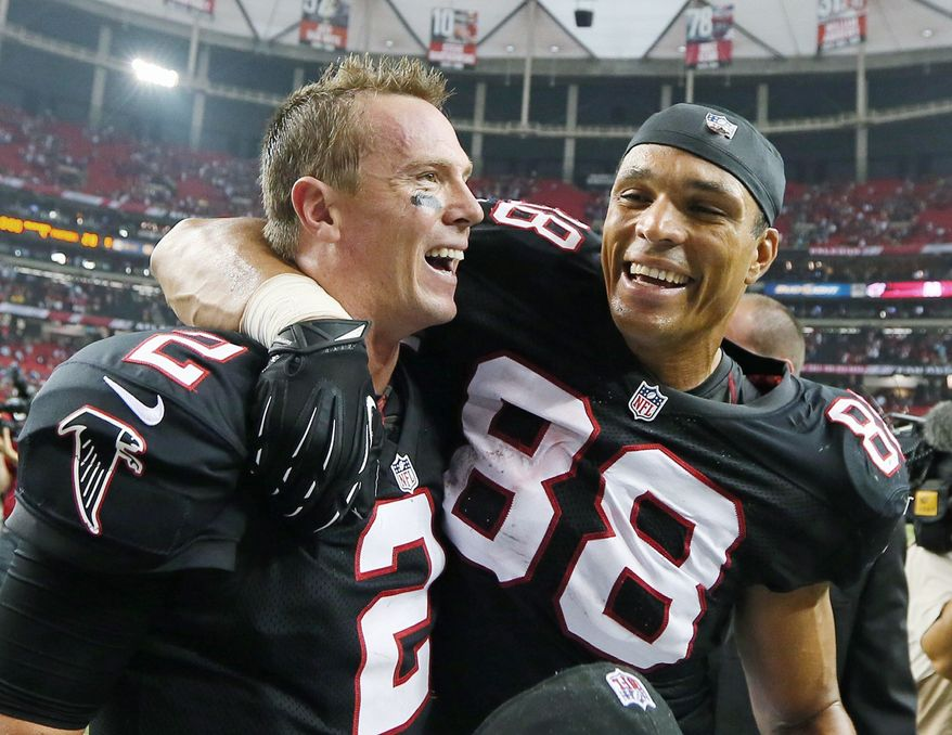 associated press Falcons quarterback Matt Ryan (left) and tight end Tony Gonzalez celebrate after Atlanta improved to 4-0 with a 30-28 victory over Carolina. Matt Bryant kicked a 40-yard field goal with 5 seconds left for the decisive points.