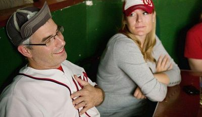 At a pub in Northwest Washington, Kevin May shows his frustration Sunday as he and fellow Washington Nationals fans Leslie Fischbeck (center) and Christie May watch the Nats lose to the 2011 World Series champion St. Louis Cardinals. (Andrew Harnik/The Washington Times)