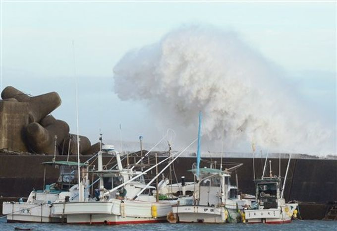 High waves hit a breakwater in Kihocho, Mie prefecture, western Japan Sunday, Sept. 30, 2012. A powerful typhoon is heading to Tokyo after injuring dozens of people, causing blackouts and paralyzing traffic in southern Japan. (Kyodo News via Associated Press)