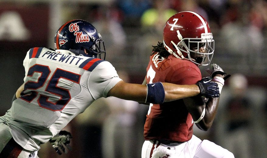 Alabama wide receiver Kenny Bell (7) runs with a reception for a first down against Mississippi defensive back Cody Prewitt (25) during the second half of an NCAA college football game Saturday, Sept. 29, 2012, in Tuscaloosa, Ala. (AP Photo/ Butch Dill)