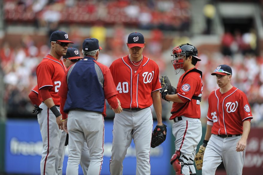 Washington Nationals pitcher Chien-Ming Wang (40) is pulled out of a baseball game by manager Davey Johnson during the fifth inning against the St. Louis Cardinals Sunday, Sept. 30, 2012, in St. Louis. (AP Photo/Bill Boyce)