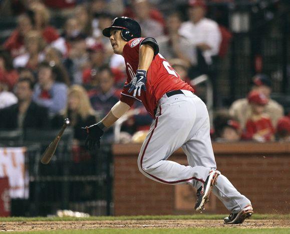 Nationals catcher Kurt Suzuki watches his game-winning double in the 10th inning Saturday night. (Associated Press)