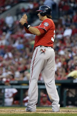 Michael Morse pantomimes a swing to get his grand slam going for the second time Saturday night. (Associated Press)