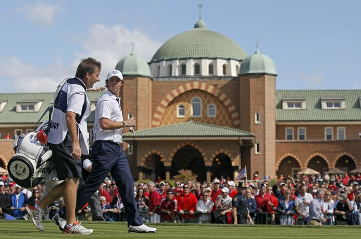 Europe's Rory McIlroy (right) walks off the first tee during a singles match at the Ryder Cup PGA golf tournament on Sunday, Sept. 30, 2012, at the Medinah Country Club in Medinah, Ill. (AP Photo/Charles Rex Arbogast)