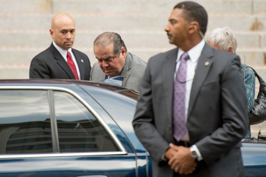 Supreme Court Justice Antonin Scalia, center, arrives to attend Red Mass at Cathedral of St. Matthew the Apostle, Washington, D.C., Sunday, September 30, 2012. (Andrew Harnik/The Washington Times)