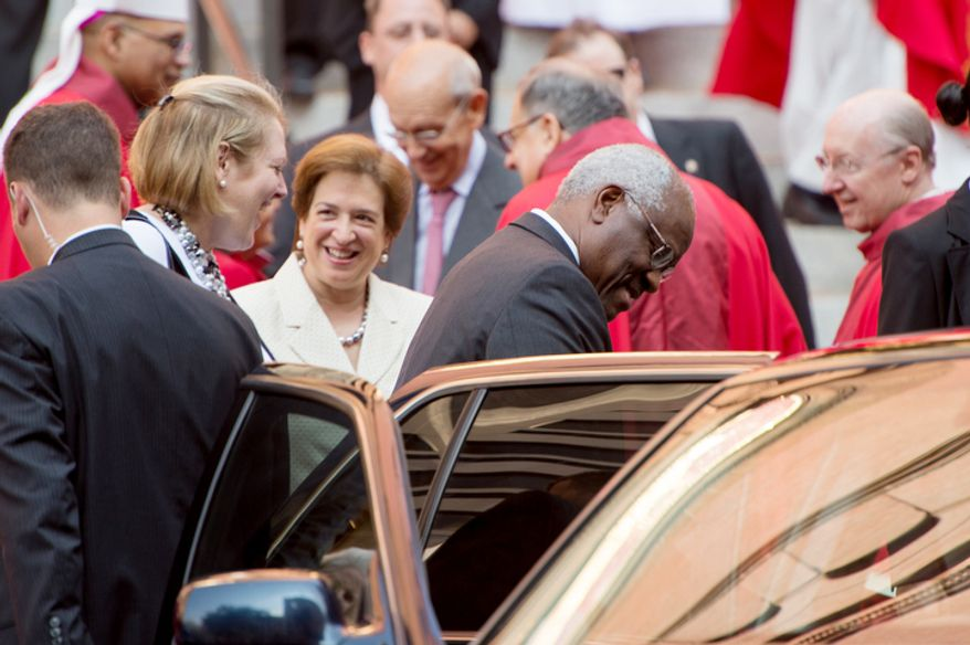 Supreme Court Justices Elena Kagan, center left, and Clarence Thomas center right, depart after Red Mass at Cathedral of St. Matthew the Apostle, Washington, D.C., Sunday, September 30, 2012. (Andrew Harnik/The Washington Times)