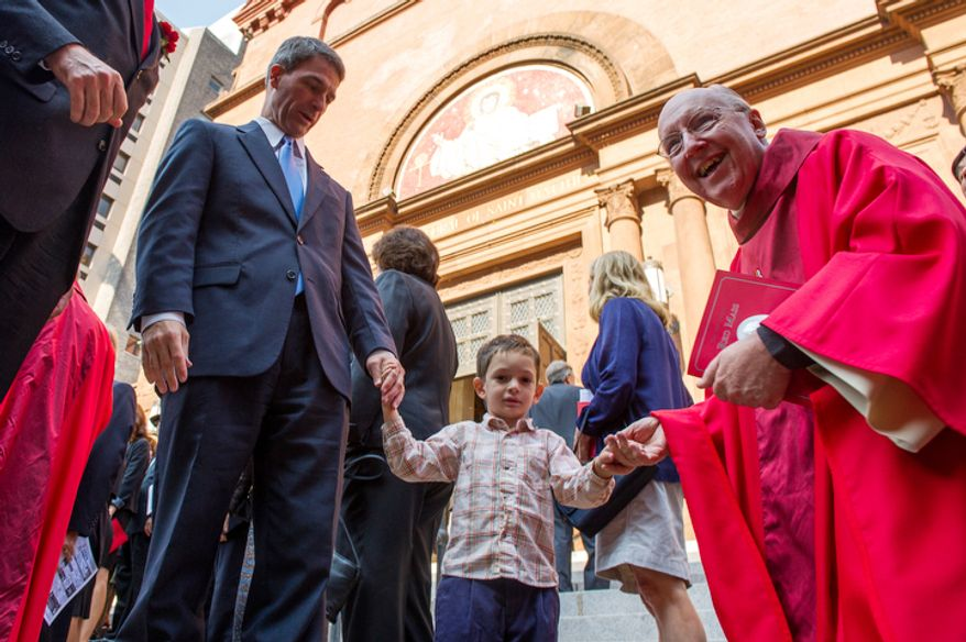 Rev. Msgr. W. Ronald Jameson, right, greets Virginia Attorney General Ken Cuccinelli, left and his son Max, 3, center, following Red Mass at Cathedral of St. Matthew the Apostle, Washington, D.C., Sunday, September 30, 2012. Red Mass, held annually in Washington, D.C. the day before the Supreme Court's new term opens is offered to invoke God's blessing and guidance on justices, judges, diplomats, attorneys and senior government officials. (Andrew Harnik/The Washington Times)