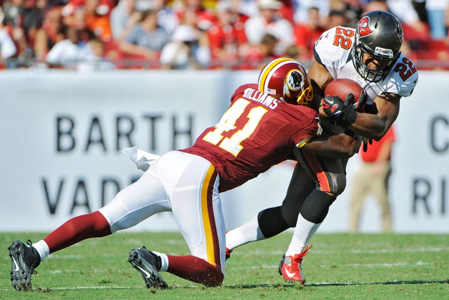 Tampa Bay Buccaneers running back Doug Martin (22) is hit by Washington Redskins free safety Madieu Williams (41) during the first quarter. (AP Photo/Brian Blanco)