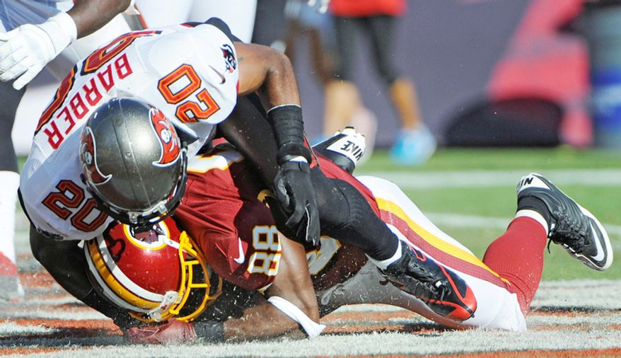 Washington Redskins wide receiver Pierre Garcon (88) is hit by Tampa Bay Buccaneers free safety Ronde Barber (20) as he recovers a fumble by quarterback Robert Griffin III in the endzone for a touchdown during the first quarter. (AP Photo/Brian Blanco)