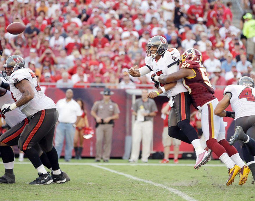 Washington Redskins outside linebacker Rob Jackson (50) knocks Tampa Bay Buccaneers quarterback Josh Freeman (5) off his feet.   (AP Photo/Margaret Bowles)
