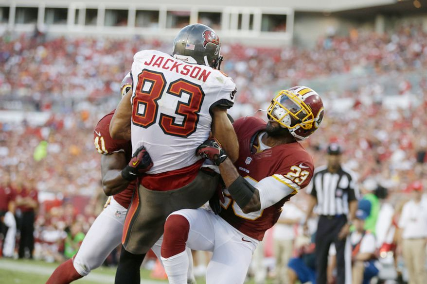 Washington Redskins cornerback DeAngelo Hall (23) tries to knock the ball loose after Tampa Bay Buccaneers wide receiver Vincent Jackson (83) caught a touchdown pass.   (AP Photo/Margaret Bowles)