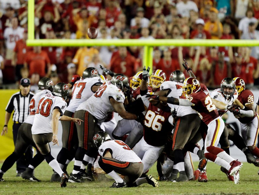 Tampa Bay Buccaneers kicker Connor Barth (10, left) kicks a 47-yard field goal against the Washington Redskins during the fourth quarter. (AP Photo/Chris O'Meara)