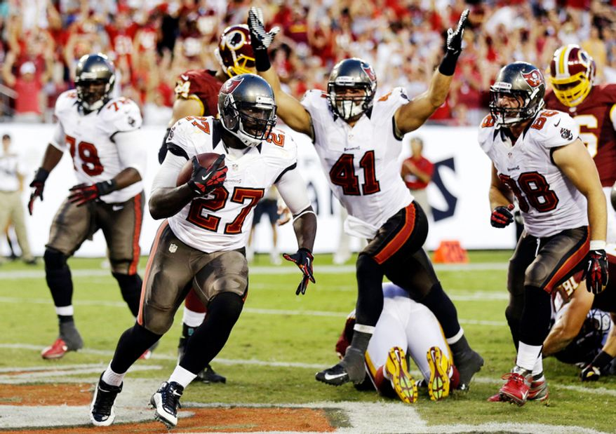 Tampa Bay Buccaneers running back LeGarrette Blount (27) scores against the Washington Redskins during the fourth quarter of an NFL football game, Sunday, Sept. 30, 2012, in Tampa, Fla. Fullback Erik Lorig (41) and tight end Luke Stocker (88) celebrate the touchdown. The Redskins won 24-22. (AP Photo/Chris O'Meara)