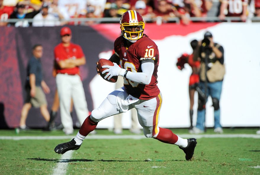 Washington Redskins quarterback Robert Griffin III (10) looks for an open receiver during an NFL football game against the Tampa Bay Buccaneers Sunday, Sept. 30, 2012, in Tampa, Fla. (AP Photo/Brian Blanco)