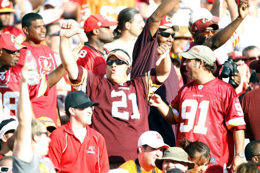 A Washington Redskin fan shows his displeasure over a call during an NFL game against the Tampa Bay Buccaneers.    (AP Photo/Margaret Bowles)