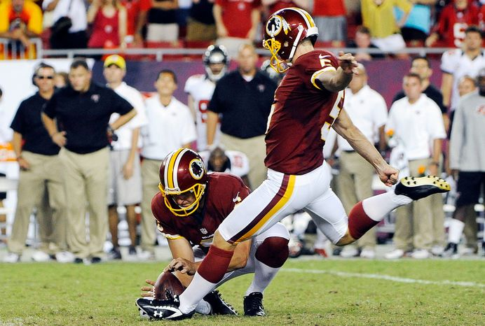 Washington Redskins kicker Billy Cundiff, right, makes the winning 41-yard field goal as Sav Rocca holds in the final seconds of an NFL football game against the Tampa Bay Buccaneers, Sunday, Sept. 30, 2012, in Tampa, Fla. The Redskins won 24-22. (AP Photo/Brian Blanco)
