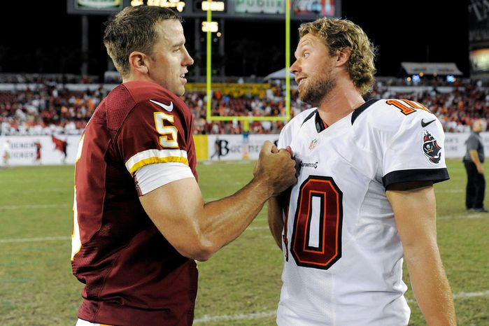 Washington Redskins kicker Billy Cundiff, left, shakes hands with Tampa Bay Buccaneers kicker Connor Barth following an NFL football game, Sunday, Sept, 30, 2012, in Tampa, Fla. Cundiff kicked a 41-yard winning field goal in the final seconds of the game to give the Redskins the 24-22 win. (AP Photo/Brian Blanco)