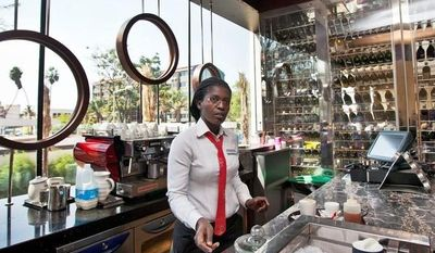 Associated Press A member of the staff prepares coffee at the cafe and wine bar of the Sankara Nairobi hotel in Kenya. Nairobi has seen the construction of several upscale properties in recent years, as developers eye an increase in business travel.