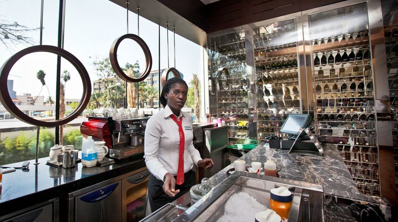 A member of the staff prepares coffee at the cafe and wine bar of the Sankara Nairobi hotel in Kenya. Nairobi has seen the construction of several upscale properties in recent years, as developers eye an increase in business travel. (Associated Press)