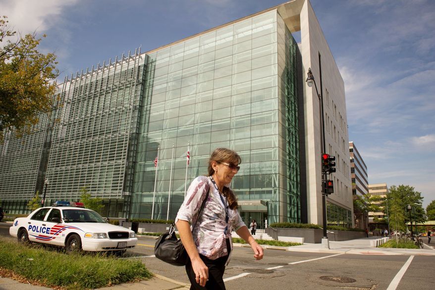 A woman walks past the Consolidated Forensics Laboratory in Washington, D.C., on Monday. The facility is a 351,000-square-foot building that consolidates public safety forensic science and public health efforts into one facility. Different divisions plan to move into the facility in waves. (Rod Lamkey Jr./The Washington Times) **FILE**