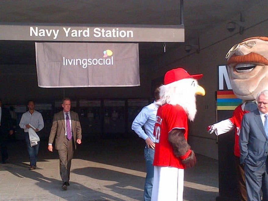 D.C. officials, Nats mascots and LivingSocial leadership unveiled LivingSocial's deal to pay for extra hours of post-season Metro service at a press conference at the Navy Yard Metro station last week. (Tom Howell Jr./The Washington Times)