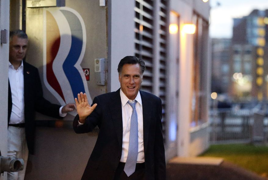 Republican presidential candidate Mitt Romney leaves his campaign headquarters in Boston on Sept. 30, 2012. (Associated Press)