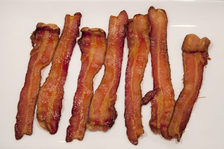 American shoppers should be able to find all the bacon they want on supermarket shelves in the coming months, though their pocketbooks may take a hit. (The Canadian Press, Jonathan Hayward)