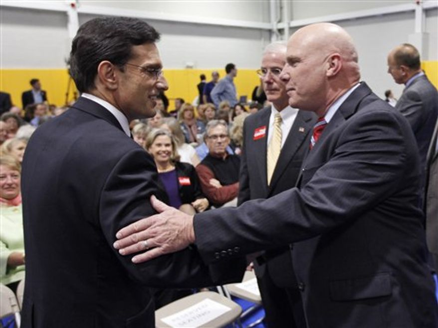 House majority leader Eric Cantor, Virginia Republican, left, and Democratic challenger Wayne Powell greet each other prior to a Chamber of Commerce debate in Richmond, Monday, Oct. 1, 2012. (AP Photo/Steve Helber)