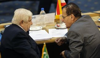 ** FILE ** Syrian Foreign Minister Walid al-Moallem (left) listens to his Lebanese counterpart, Adnan Mansour, at the Nonaligned Movement summit in Tehran on Friday, Aug. 31, 2012. (AP Photo/Vahid Salemi)