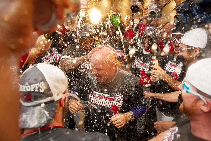 Mike Rizzo, center, celebrates making the playoffs with the team after the Washington Nationals in their locker room at Nationals Park, Washington, D.C., Monday, October 1, 2012. (Andrew Harnik/The Washington Times)