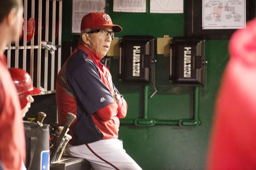 Washington Nationals manager Davey Johnson (5) watches from the dugout as the Washington Nationals play the Philadelphia Phillies. (Andrew Harnik/The Washington Times)