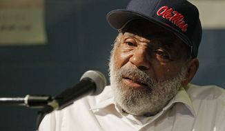 James Meredith, the first black student to enroll at the University of Mississippi in 1962, speaks to an audience at a reading at a Jackson, Miss., bookstore, on Tuesday, Aug. 14, 2012.  (AP Photo/Rogelio V. Solis)
