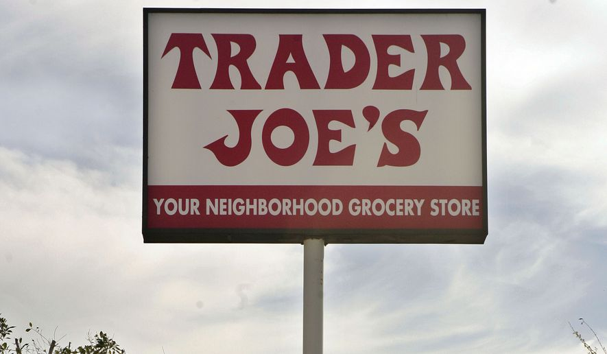 A customer departs grocery store Trader Joe's in Los Angeles on Feb. 11, 2008. (Associated Press) ** FILE **