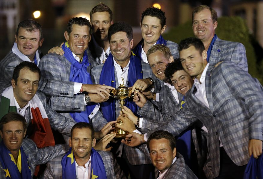 The European team posses with the trophy after winning the Ryder Cup PGA golf tournament Sunday, Sept. 30, 2012, at the Medinah Country Club in Medinah, Ill. (AP Photo/David J. Phillip)