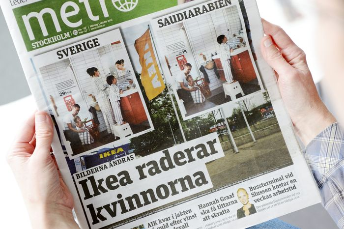 A person holds the Oct. 1 2012, issue of daily Metro fronted with two images from the Swedish and Saudi Arabian IKEA catalogues for next year. Ikea is being criticized for deleting images of women from the Saudi version of its furniture catalogue, a move the company says it regrets. (AP Photo/Scanpix Sweden)