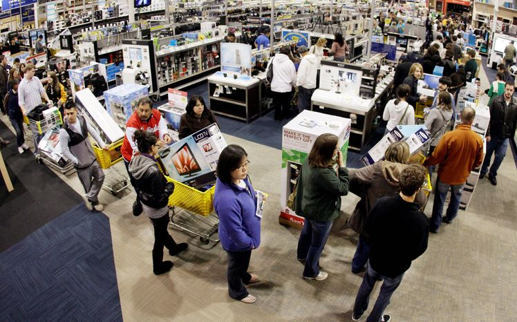 A checkout line is backed up at a Best Buy store during a midnight Black Friday sale in Brentwood, Tenn., on Nov. 25, 2011. Holiday sales are expected to rise just 4.1 percent this year. Increases were 5.6 percent in 2010 and 5.5. percent in 2011. (Associated Press)