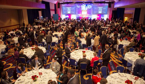"""People make their way into the ballroom for the evening dinner, during """"A Symposium on Values and Consequences"""" as part of the 30th anniversary celebration of The Washington Times at the Marriott Wardman Park Hotel in Washington, D.C., Tuesday, Oct. 2, 2012. (Rod Lamkey Jr./The Washington Times)"""