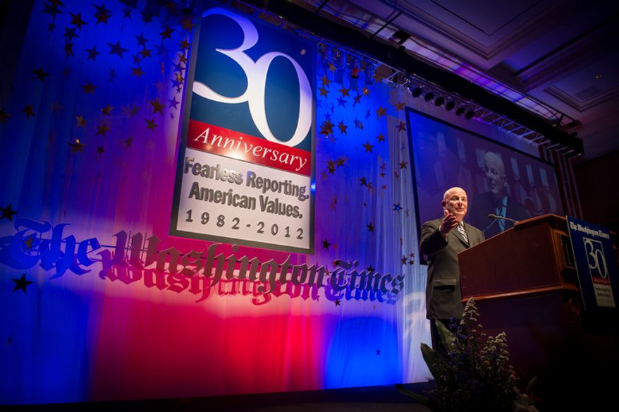 Thomas P. McDevitt, president of The Washington Times, welcomes guests during the evening banquet as part of the 30th anniversary celebration of The Washington Times at the Marriott Wardman Park Hotel in Washington, D.C., Tuesday, Oct. 2, 2012. (Rod Lamkey Jr./The Washington Times)