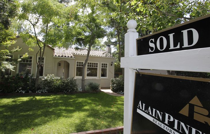 """A """"sold"""" sign is displayed outside a home in Palo Alto, Calif., on Tuesday, Aug. 21, 2012. (AP Photo/Paul Sakuma)"""