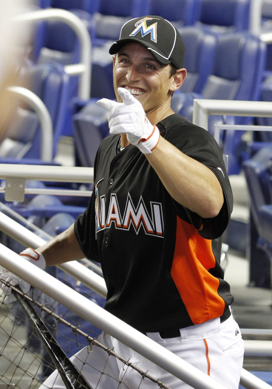 Adam Greenberg heads out of the dugout for batting practice before a baseball game against the New York Mets in Miami, Tuesday, Oct. 2, 2012. The Marlins signed the former Chicago Cubs prospect to a one-day contract effective Oct. 2. He is to bat as a pinch-hitter against the Mets. (AP Photo/Alan Diaz)