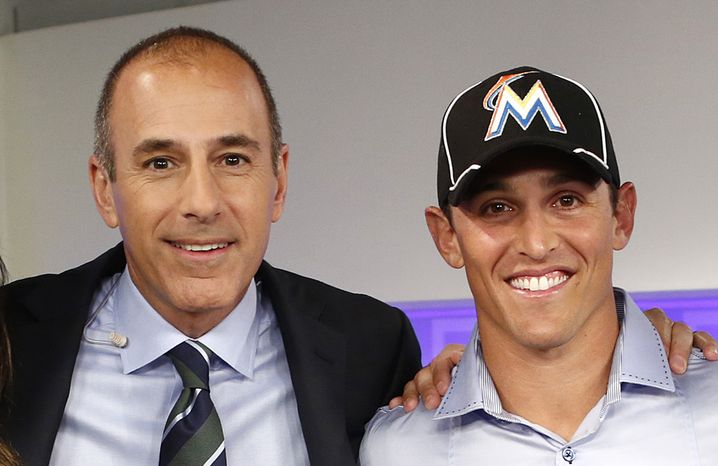 "This image released by NBC shows host Matt Lauer, left, posing with Adam Greenberg after an appearance on the ""Today"" show, Thursday, Sept. 27, 2012 in New York. The Marlins said Thursday that they have signed Greenberg to a one-day contract, effective Oct. 2, and will play him that day against the New York Mets. Greenberg made his big-league debut for the Chicago Cubs on July 9, 2005 against the Marlins, getting one plate appearance but no official at-bat after a 92 mph fastball that struck him in the head. Greenberg was the subject of a campaign called ""One At Bat,"" which lobbied teams to give him a second chance.  The Marlins publicly extended the invitation to Greenberg on NBC's ""Today"" show Thursday morning.  (AP Photo/NBC NewsWire, Peter Kramer)"