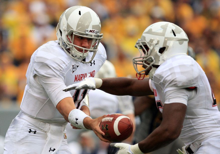 Maryland qauterback Perry Hills (11) hands the ball off to Brandon Ross (45) during an NCAA college football game against West Virginia in Morgantown, W.Va., Saturday, Sept. 22, 2012. (AP Photo/Christopher Jackson)