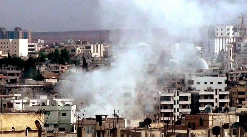 This image taken from video obtained from the Shaam News Network, which has been authenticated based on its contents and other AP reporting, shows smoke rising from buildings after government shelling in Daraa, Syria, on Tuesday, Oct. 2, 2012. (AP Photo/Shaam News Network via AP video)