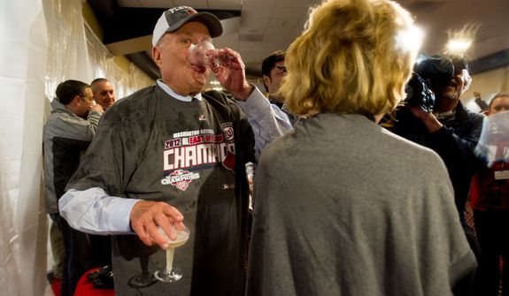 Owner Ted Lerner sips Champaign as the Washington Nationals clinch the National League East at Nationals Park, sending them into the playoffs, Washington, D.C., Monday, October 1, 2012. (Andrew Harnik/The Washington Times)