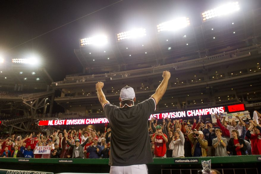 Washington Nationals third baseman Ryan Zimmerman (11) gets a huge cheer from the crowd as the Washington Nationals clinch the National League East at Nationals Park, sending them into the playoffs, Washington, D.C., Monday, October 1, 2012. (Andrew Harnik/The Washington Times)