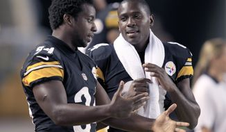 Pittsburgh Steelers running back Rashard Mendenhall (34) and wide receiver Antonio Brown (84) talk on the sideline during an NFL pre-season football game against the Carolina Panthers  in Pittsburgh, Thursday, Aug. 30, 2012. (AP Photo/Gene J. Puskar)