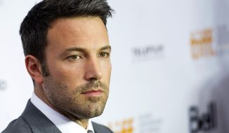 "Actor-director Ben Affleck pauses for a photograph on the red carpet at a gala for his new movie, ""Argo,"" during the 37th annual Toronto International Film Festival in Toronto on Friday, Sept. 7, 2012. (AP Photo/The Canadian Press, Nathan Denette)"