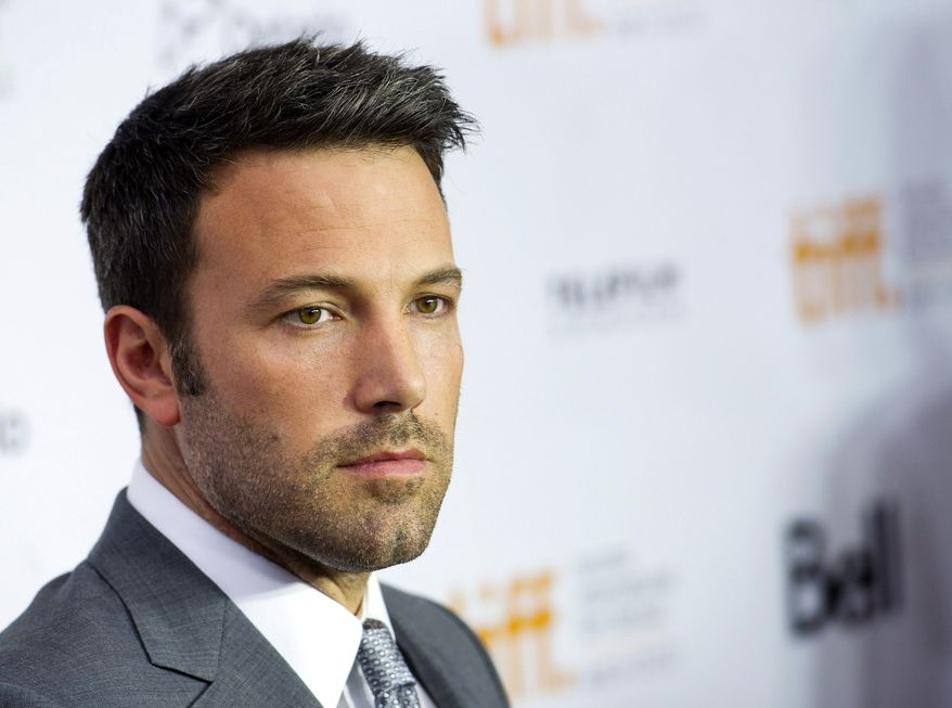 """Actor-director Ben Affleck pauses for a photograph on the red carpet at a gala for his new movie, """"Argo,"""" during the 37th annual Toronto International Film Festival in Toronto on Friday, Sept. 7, 2012. (AP Photo/The Canadian Press, Nathan Denette)"""
