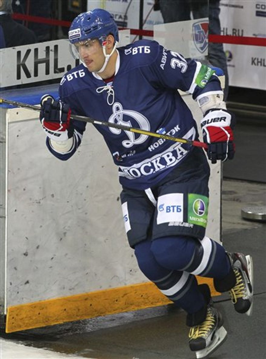 Washington Capitals star forward Alexander Ovechkin, of Russia, enters the rink before the Continental Hockey League, or KHL, ice hockey match between Dynamo Moscow and Dynamo Minsk, in Moscow on Thursday, Sept. 20, 2012. Ovechkin has returned to his former Russian team Dynamo Moscow during the NHL lockout. The KHL team said in a statement Wednesday, Sept. 19, 2012, that they have signed the Capitals star to a contract that lasts until the lockout ends. (AP Photo/Alexei Bezzubov, KHL)